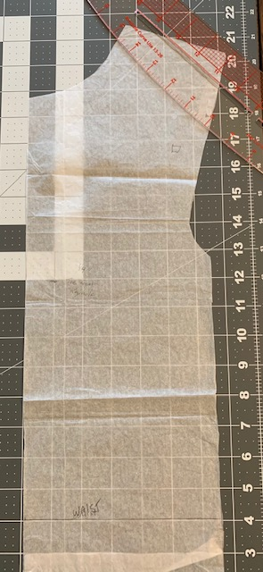 This is the sub-pattern to cut along the front and back panels on their respective sides so they match on the asymmetric left open side of the dress.