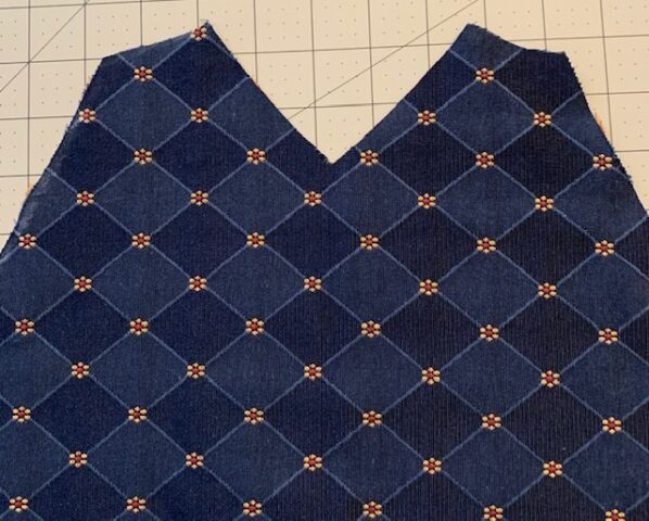 The left side panel spread out to show the lower edge of the deep armhole.