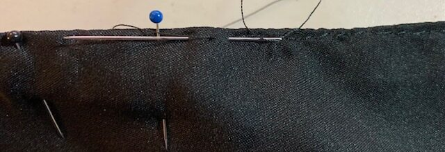 Under-stitching the liner to the pellote proper.