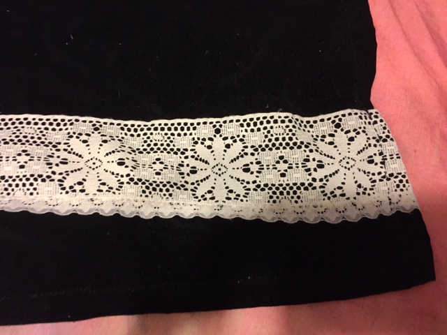 lace sewn with black thread visible on the side seam